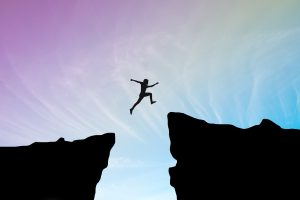 Mentor Guidelines person jumping from edge of cliff to another