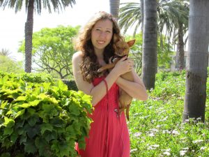 Our daughter with her dog in tropical setting